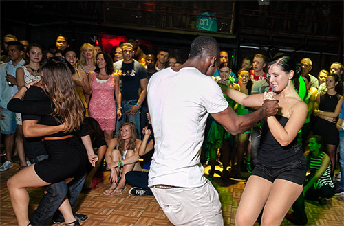 Modern Latin ballroom dance at night club